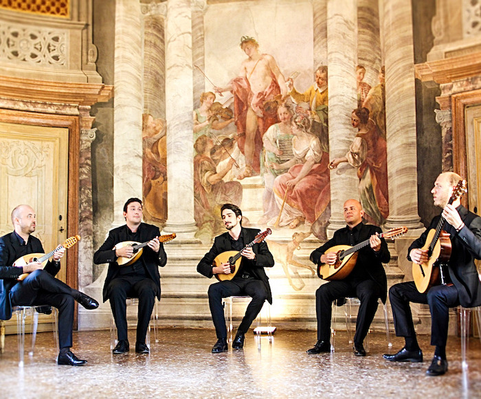 "Immersed in the wonderful Tintoretto's Hall of Scala del Bovolo, the ensemble will accompany you with the unique voice of the mandolins on an evocative musical journey. The ticket includes the free visit of the ""Scala del Bovolo"" from 8.00 pm"